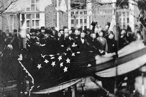 President Lincoln, en route to Washington for his inauguration, raises a flag in Philadelphia to honor the new state of Kansas. Photograph courtesy of the Library of Congress.